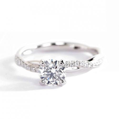 0.65 Carat SI2 H Twist Shank Round Cut Diamond Engagement Ring Platinum