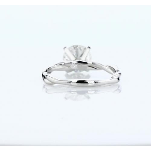 0.65 Carat VS2 F Twist Shank Round Cut Diamond Engagement Ring Platinum
